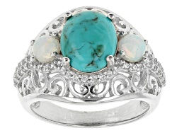 NGH452<br>10x8mm Oval Cabochon Turquoise With .68ctw Round Ethiopian Opal And Zircon Sterling Silver
