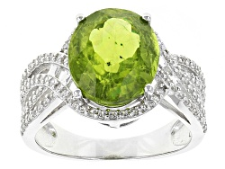 DOCX344<br>6.10ct Oval Peridot With .76ctw Round White Zircon Sterling Silver Ring